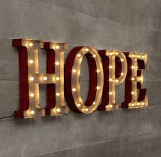 """RH's Vintage Illuminated Marquee Words - Hope: Standing at just over 13"""" tall, our grandly sized illuminated words capture the spirit of the season and the character of a vintage theater marquee. Crafted of iron with a weathered red finish, they shine bright via tiny white lights."""