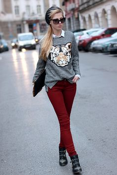 Animal sweater + dark red jeans