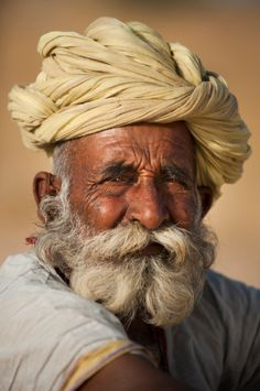 Like the turban curly beards and moustaches are a part of Rajasthan