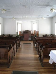 AFS bought Collins Springs with the intention of converting it into their headquarters and meeting hall. Cosmetically, there wasn't much the group needed to do to convert the church into their hall. Primitive Baptists don't adorn their churches with steeples and stained glass.  Southern also restored the church's original pews, though now they're called seating benches. The lectern also remained, but now it's used for guest lecturers, not preachers. Meeting Hall, Adaptive Reuse, Church Building, Big Houses, Atheist, Benches, Stained Glass, Primitive, Restoration
