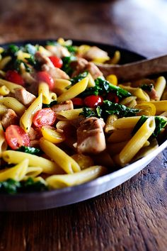 Pasta w/ kale and tomatoes. I'd skip  much of the butter/oil and pasta - haha but the veggies and garlic sauce sound amazing :)