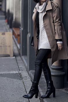 This classic brown trench coat looks edgy and sophisticated worn with leather leggings and heeled ankle boots. Via Claire Liu.Sweater: Zara, Jacket: Vero Moda, Coat: Korean brand, Leggings: H&M, Boots: Sam Edelman.