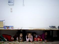 Israeli children taking cover during rocket attack