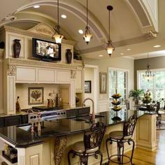 Don't like the black counter-top, but I do like the paint colors for a kitchen The chairs and sconces are a little to ornate for our taste