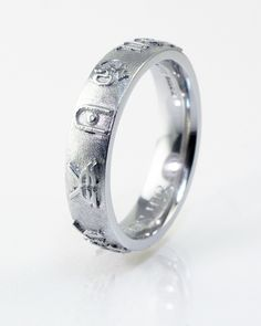 Platinum Wedding ring for men by AJC.  Featuring with Indian symbols (Tilak, OM and Rupee) More details at www.advancedjc.com or call 02921 328 114 #indianwedding #indianweddingring #bespokeweddingring #platinummensring