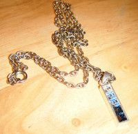 """Silvertone 23""""long chain with 1""""high pendant with 5 stones in blue/clear"""