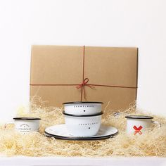 A Best Made Seamless & Steadfast enamel gift box that includes 2 cups, 2 bowls, and 2 plates, securely stowed in our gift box, packed with wood wool, and tied for safe measure with a bow of red waxed twine. Seamless & Steadfast Enamel Set: http://bit.ly/I52AQs