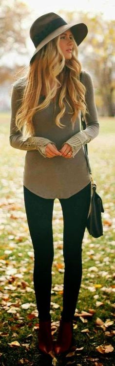 Consider wearing an army green v-neck jumper and black leggings for an unexpectedly cool ensemble. Add oxblood ankle boots to your look for an instant style upgrade.