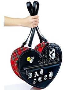 Current Mood Bad Seed Tote Bag is gunna get yer azz kicked outta class in a second, bb~! Lean into yer bad grrl reputation with this sikk heart shaped tote bag, featurin' smooth black vegan leather 'N classikk red plaid construction, top zip closure, a roomy interior with slip pocket, anatomical skull patch, patchwork old English lettering spellin' out 'BAD SEED,' tonz of safety pin detailing, vulgar lil pins, and long shoulder straps.