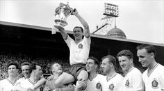 Nat Lofthouse lifts the FA Cup in 1958 after Bolton had beaten Manchester United.