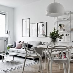 An open-plan living/dining room. String Furniture available online.