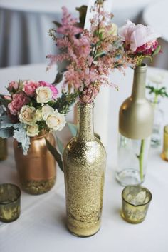 Table setting - gold vases with soft florals