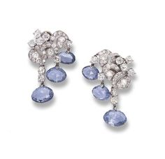 A PAIR OF SAPPHIRE AND DIAMOND EAR PENDANTS, BY CARTIER   Each designed as a diamond scroll and collet top suspending three oval briolette-cut sapphires, circa 1935, with French assay mark for platinum and gold  Signed Cartier Paris and with maker's mark for Cartier, no. 01012