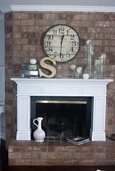 DIY mantle... Like the variety of vases and something different on the other end.