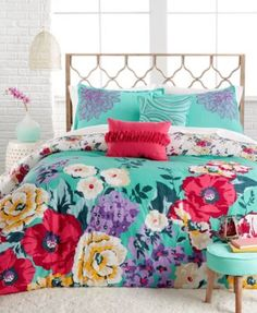 Helena 5-Piece Comforter and Duvet Set $69.99 Refresh your room with bursts of color with the reversible Helena Comforter Set, featuring a bold floral print in bright red, yellow and purple hues on a green ground. A smaller floral print is on the reverse on a smooth ivory ground, and shams and decorative pillows add texture with pleating and embroidery accents.