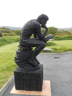 'Le Poete' inspired by Rodin's - The Thinker; Made from old bike tyres