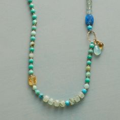 """SOL DE SKY NECKLACE--Citrine glitters amidst the blues of turquoise, lapis and chrysoprase in a necklace accented with prehnite, chalcedony, glass seed beads and a 14kt gold oval and toggle. USA. Exclusive. 30""""L."""