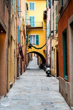 https://flic.kr/p/ppFXMr One of the streets in the old town section of Villefranche-sur-Mer, France.    Villefranche-sur-Mer is a small town which adjoins Nice on the French Riviera.  The town sits on a natural harbor and has been inhabited since the time of the Greeks. It is a popular stop for many cruise ships in the Mediterranean Sea