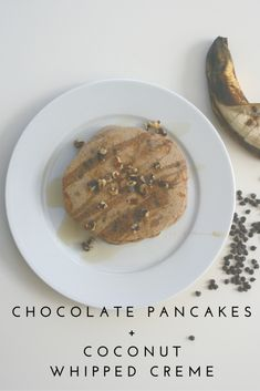 Banana Pancakes + Coconut Whipped Creme | Tired of plain ol' pancakes? This vegan and dairy free recipes is made with bananas and chocolate chips and topped with whipped creme made from coconut milk. These kid-friendly pancakes will be a sweet treat in the morning or for dinner, and would make any child or adult happy on Christmas morning.