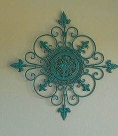 Metal Wall Décor. This solid metal décor has shades of dark teal and browns---a shabby chic finish!!  Perfect addition for any wall!! Size: 22