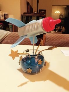 Bottle Rocket Centerpieces For Space Themed Baby Shower.
