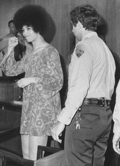 Angela Davis in her trail wearing a floral printed A-Line mini dress with bell shaped sleeves, another key element in fashion from the 1960s'.