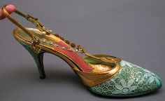 ELSA SCHIAPARELLI - Shoes - 1950 -      These beautiful shoes in green and gold have a lace overlay with gold glitter underneath. The straps and scroll are gold leather, while the vamp straps is gold with rhinestone jewels. The interior leather is green, with a gold insole