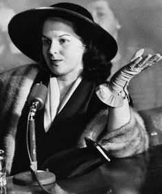 Mink-bedecked Virginia Hill Hauser, one-time girl friend of slain mobster Bugsy Siegel, listens to a question from the Senate crime probers in New York, March 1951 and provides an answer with an expressive wave of her hand. Mickey Cohen, Waterbury Connecticut, Bugsy Siegel, Virginia Hill, Frank Costello, Flamingo Hotel, Chicago Outfit, Mafia Gangster, The Girlfriends