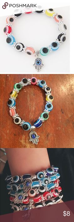 HAMSA BRACELET Stretchy bracelet.  Alloy spacers and hand. I think the charms are plastic. Light weight.  Boutique items may or may not have a tag but are direct from vendor and brand new. Jewelry Bracelets