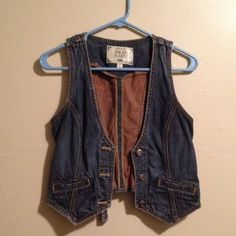 Old Navy Denim Adjustable Waist Vest sz S Cute denim vest with functioning pockets on either side, 3 buttons down front, and waist adjuster belt in back as shown in images. Denim has a cool brownish tint to it. Only worn once, very good condition. Old Navy Jackets & Coats Vests