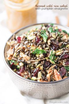 Wild rice is tossed with dried cranberries, pecans and kale and topped with a delicious pumpkin vinaigrette! Perfect as a side dish or complete meal!