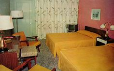 Coronado Court - Melbourne, Florida -- Either someone decided to put all of the motel's best furniture in the room for the shot, or these are unusually small room. No matter: that is a wonderfully mod lamp and shade on the left.