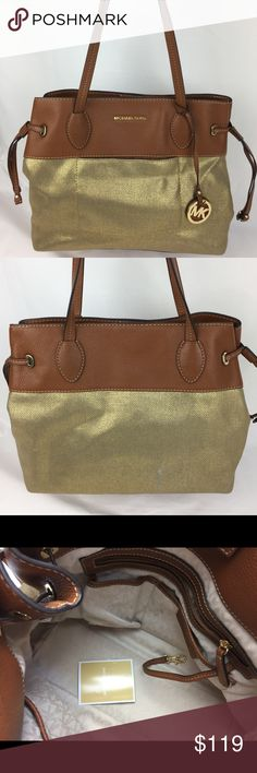 MICHAEL KORS Marina Large Canvas Tote - Gold Condition: Exterior: Grade B with signs of use. Bags needs a good cleaning, that may remove some or all exterior marks. Interior: Grade B with some marks. Hardware: Grade A-.  Price accordingly - please see photos.  1 main open pocket with magnetic snap closure, 1 Interior zipper pocket, 4 interior slip pockets and two shoulder straps with 10-1/2 inch drop. Dimensions: 11-1/2 inches H x 13.5 inches W x 5.5 inches D  Thank you for your interest! No…