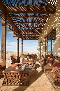 Architectural Digest ~ Ted Turner's Home Beautiful equipale living room; vintage Mexico furniture