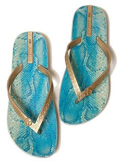 739af49af4eb Super comfortable flip flops with turquoise python print on cushioned  footbed. Gold flexible straps with