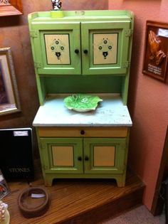 Amazing antique child-size kitchen hutch spotted at a second hand store.