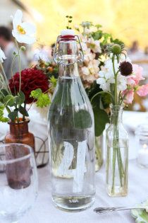 using vintage bottles for centrepieces