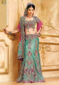 BW51 Sea Green & Rose Pink Lehenga GHAGRA CHOLI A heavily embroidered cutwork choli with stylized a rose pink sleeves combined with trumpet styled banarasi brocade skirt with rose pink silk with a rose pink net cutwork border and pallu dupatta.