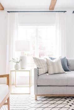 Living room decor. Grey couch.White bright home decor