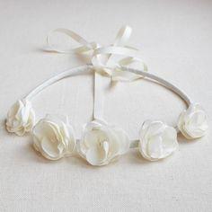 http://adornatelier.ca/item_932/Cream-Petite-Blossom-Tie-Up-Crown.htm