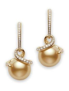Twist Golden South Sea Earrings  Twist is a collection of organic, free-form designs intended to showcase the pearl from all angles. These earrings feature 11mm Golden South Sea cultured pearls and 0.45ct of diamonds, set in 18k yellow gold. Mikimoto