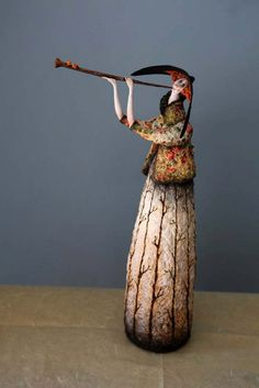 Katia was born in Russia, Siberia but now is living in Cyprus. This can be a reason for the warm color palette used for her papier mache and clay doll sculpture what quite recall the way of Rubens. The doll sculptures usually are 28 – 30 cm tall