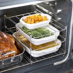 Expandable oven rack - sur la table $9.99. Easy-to-assemble rack expands cooking space in your oven then folds flat for storage! Anyone who has cooked a Thanksgiving or Christmas meal, knows this is absolutely necessary if you have a single oven!