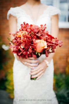 From Cheryl and Ryan's wedding at The Canal. Love Cheryl's red and orange bridal bouquet!