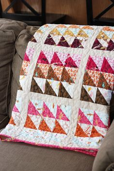 "MendocinoQuilt - ""A simple quilt, made of 20 nine-patch blocks with sashing.  Instead of white, I used Windham 1930's Ivory solid for the sashing and I love how warm it looks.  (The nine-patches are made of half-square triangles, and each HST unit measures 3"".)""  coming March 2016  Windham Fabrics is reissuing Heather Ross' gorgeous line Mendocino."