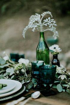 Emerald wedding table decor   Image by Jessie Schultz Photography