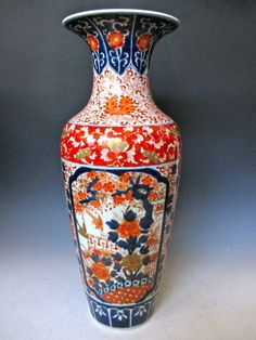This decorative vase belongs to the Ancient Japanese era. This style utilised bright colours to decorate ornaments such as vases.