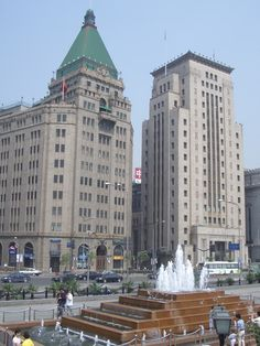 Peace Hotel and Bank of China, two Art Deco master pieces standing next to eachother on the Bund in Shanghai, China