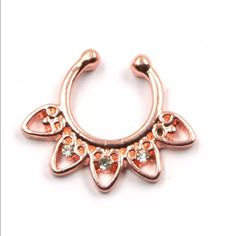 Septum Nose Ring (Fake) ONLY 1 LEFT. This is fake. It's a clip on. Never worn. Comes new & in package. More than one available. Trade Value: $20 No Brand Jewelry Rings