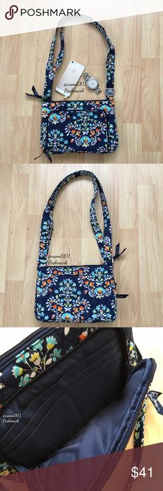Vera Bradley Little Hipster Chandelier Floral NWT This adorable small purse with built in wallet is perfect for the girl on the go and wants to be hands free. Converts from a shoulder bag to a crossbody by adjusting the straps. Pretty dark blue color. For a little purse, it's very roomy. You won't need a wallet as the front zippered pocket has a paper money slot and 4 credit card slots. Main compartment has a zippered pocket on the inside. Back of the purse has a slip pocket with hidden…